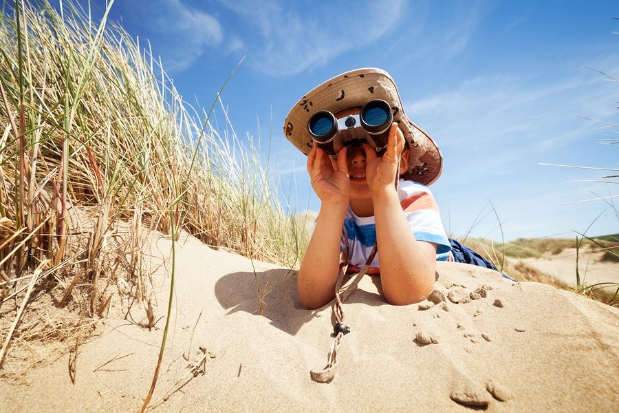 Little boy searching with bino 65389099
